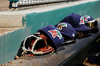 Fort Myers Miracle hats and gloves sit on the dugout steps during a game against the Jupiter Hammerheads on April 9, 2013 at Hammond Stadium in Fort Myers, Florida.  Fort Myers defeated Jupiter 1-0.  (Mike Janes/Four Seam Images)