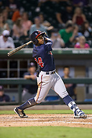 Ronald Acuna (24) of the Gwinnett Braves follows through on his swing against the Charlotte Pitmasters at BB&T BallPark on July 15, 2017 in Charlotte, North Carolina.  The Braves defeated the Pitmasters 9-4.  (Brian Westerholt/Four Seam Images)