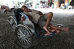 A cyclo driver sleeps under a bridge in District 4, Ho Chi Minh City, Vietnam. Sept. 9, 2011.