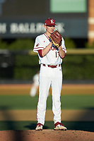 Elon Phoenix starting pitcher George Kirby (13) looks to his catcher for the sign against the Quinnipiac Bobcats at David F. Couch Ballpark on February 24, 2019 in  Winston-Salem, North Carolina. (Brian Westerholt/Four Seam Images)