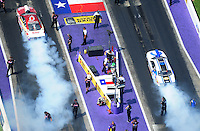 Apr. 28, 2012; Baytown, TX, USA: Aerial view of NHRA pro stock driver Greg Anderson (left) burns out alongside Allen Johnson during qualifying for the Spring Nationals at Royal Purple Raceway. Mandatory Credit: Mark J. Rebilas-