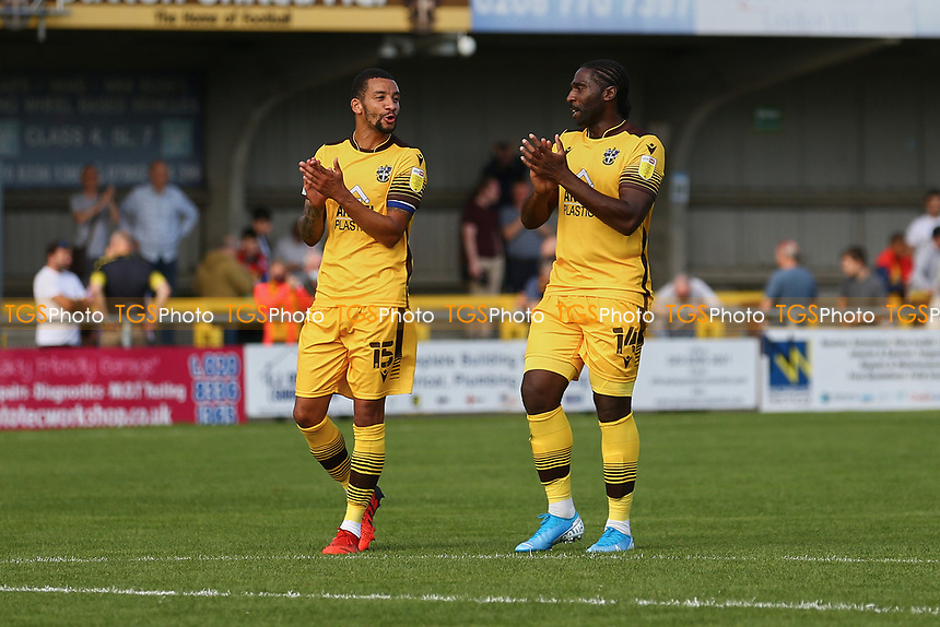 Craig Eastmond (L) of Sutton United and Craig Dundas of Sutton United applauds the fans during Sutton United vs Stevenage, Sky Bet EFL League 2 Football at the VBS Community Stadium on 11th September 2021