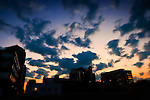 View of western sky and buildings in Downtown Dayton Ohio at sunset.