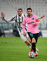 Football Soccer: UEFA Champions League -Group Stage-  Group G - Juventus vs FC Barcellona, Allianz Stadium. Turin, Italy, October 28, 2020.<br /> Barcellona's captain Lionel Messi (r) in action with Juventus' Adrien Rabiot (l) during the Uefa Champions League football soccer match between Juventus and Barcellona at Allianz Stadium in Turin, October 28, 2020.<br /> UPDATE IMAGES PRESS/Isabella Bonotto