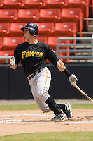 Tony Sanchez #29 of the West Virginia Power follows through on his swing versus the Hickory Crawdads at L.P. Frans Stadium August 9, 2009 in Hickory, North Carolina. (Photo by Brian Westerholt / Four Seam Images)