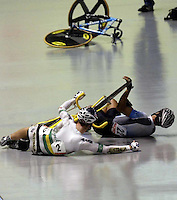 World track championships in Melbourne. Australia's Mark Renshaw lies tangled with Uruguay's Milton Wynants on the apron of the track after they crashed. Wynants remounted and went on to claim silver.