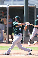 Miles Head #14 of the Oakland Athletics bats during a Minor League Spring Training Game against the Los Angeles Angels at the Los Angeles Angels Spring Training Complex on March 17, 2014 in Tempe, Arizona. (Larry Goren/Four Seam Images)