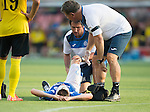 Alashkert FC v St Johnstone...02.07.15   Republican Stadium, Yerevan, Armenia....UEFA Europa League Qualifier.<br /> Murray Davidson is treated for his knee injury<br /> Picture by Graeme Hart.<br /> Copyright Perthshire Picture Agency<br /> Tel: 01738 623350  Mobile: 07990 594431