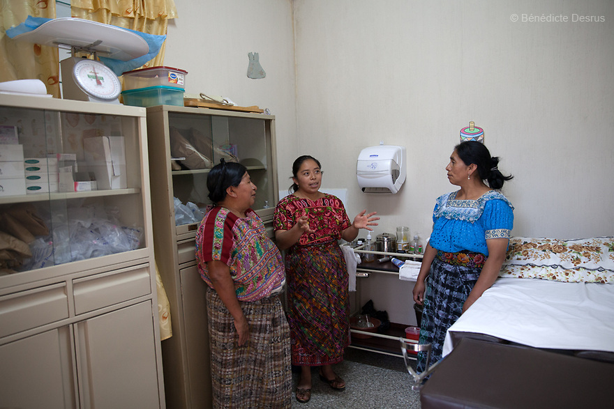 For GLOBAL FUND FOR WOMEN<br /> <br /> Gloria portrayed at the clinic with 2 others midwifes. Gloria Marina Icu Puluc from Asociación Civil de Comadronas Tradicionales de Chimaltenango (ACOTCHI) in San Juan Comalapa, Guatemala on August 20, 2015. Photo credit: Bénédicte Desrus