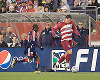 FC Dallas forward Kenny Cooper (33) brings the ball down wing as New England Revolution forward Kheli Dube (11) closes. The New England Revolution defeated FC Dallas, 2-1, at Gillette Stadium on April 4, 2009. Photo by Andrew Katsampes /isiphotos.com