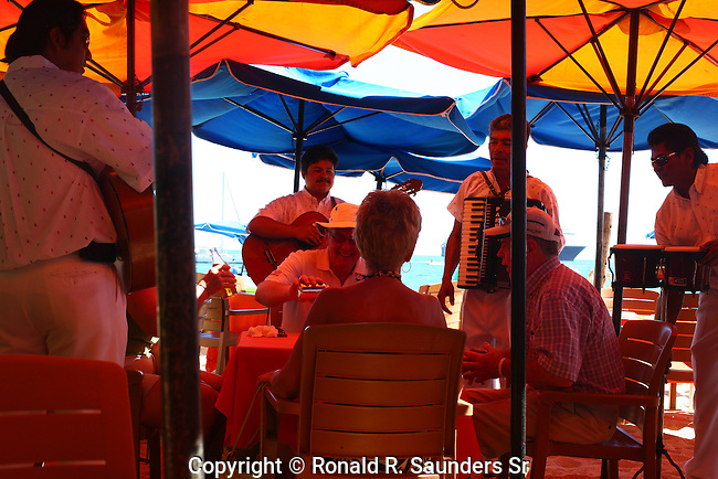 Mexican musicians entertain tourists in sea side resturant