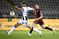 Jens Stryger Larsen of Udinese Calcio and Andrea Belotti of Torino FC  compete for the ball during the Serie A football match between Torino FC and Udinese at Olimpico stadium in Torino ( Italy ), June 23th, 2020. Play resumes behind closed doors following the outbreak of the coronavirus disease. <br /> Photo Image Sport / Insidefoto