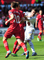 sport...swansea v southampton...liberty stadium...saturday 20th april 2013....<br /> <br /> <br /> Swansea's Pablo Hernandez takes a blow to the face.