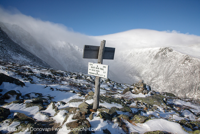 Mount Washington - Tuckerman Ravine in extreme weather conditions from Boott Spur Trail in the White Mountains, New Hampshire USA during the winter months. Strong winds cause snow to blow across the mountain tops. From this point, Davis Path is 0.7 miles.