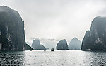 Early morning view of Ha Long Bay shrouded in mist, fog and rain.