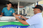 Mario Morales serves Zack Elbay at his Yummy Dog food truck on Durham Thursday Oct 09, 2014.(Dave Rossman photo)