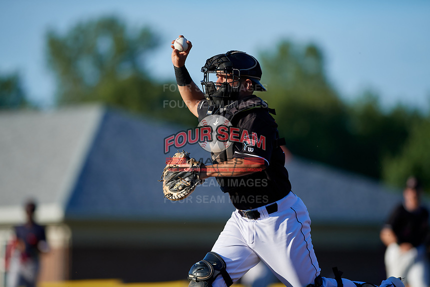 Batavia Muckdogs Michael Hernandez (29) forces a base runner back to third base in a run down during a NY-Penn League game against the State College Spikes on July 1, 2019 at Dwyer Stadium in Batavia, New York.  Batavia defeated State College 5-4.  (Mike Janes/Four Seam Images)