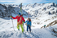 The Ortler Group in northern Italy is a popular region for spring ski touring using the huts for overnights to ski all the many peaks in the mountain group. Climbing Monte Pasquale 3553 meters with skis on the pack.