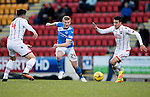 St Johnstone v Ross County… McDiarmid Park..     SPFL<br />Brian Easton is closed down by Christopher Routis and Tim Chow<br />Picture by Graeme Hart.<br />Copyright Perthshire Picture Agency<br />Tel: 01738 623350  Mobile: 07990 594431
