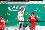 Usain Bolt and Mercedes driver Lewis Hamilton (44) of Great Britain on the podium after the Formula 1 United States Grand Prix race at the Circuit of the Americas race track in Austin,Texas.