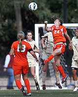 University of Miami defender Tara Schwitter (24) heads the ball. .After two overtime periods, Boston College (gold) tied University of Miami (orange), 0-0, at Newton Campus Field, October 21, 2012.