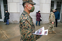 NEW YORK, NEW YORK - FEBRUARY 4:  US marines give information to people during COVID-19 vaccination hub at Yankee Stadium on February 5, 2021 in New York City. Yankees legend Mariano Rivera visit the Yankee Stadium on Friday as it was transformed into a COVID-19 vaccination mega-facility for resident of the zone. (Photo by Eduardo MunozAlvarez/VIEWpress)