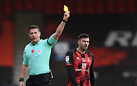 31st October 2020; Vitality Stadium, Bournemouth, Dorset, England; English Football League Championship Football, Bournemouth Athletic versus Derby County; Referee Robert Jones shows a yellow card to Diego Rico of Bournemouth