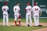 Greenville Drive infielders pause for the National Anthem before a game against the Asheville Tourists on Tuesday, August 31, 2021, at Fluor Field at the West End in Greenville, South Carolina. They are Brandon Howlett (35), Christian Koss (8), Nick Yorke (4) and Joe Davis (34. (Tom Priddy/Four Seam Images)