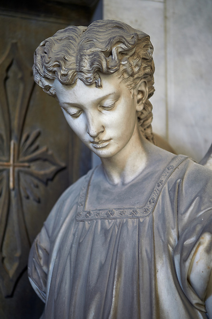 Picture and image of the stone sculpture of an angel at the doors of the Pallavicino Family tomb, sculpted by A Rivalta 1896. Section D no 27, the monumental tombs of the Staglieno Monumental Cemetery, Genoa, Italy