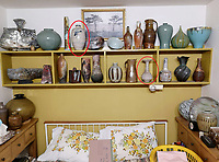 BNPS.co.uk (01202 558833)<br /> Pic: AdamPartridgeAuctioneers/BNPS<br /> <br /> Pictured: Main bedroom where their favourite pots were kept including a Jim Malone pot (CIRCLED, LEFT) and a Lucie Rie fluted stoneware bottle (CIRCLED,RIGHT). <br /> <br /> A huge collection of pottery and ceramics found stacked inside the suburban home of an elderly couple has sold for almost £200,000.<br /> <br /> Leonard and Alison Shurz filled every room of their three bed house with ceramic pieces they had gathered from all over the world.<br /> <br /> The Aladdin's Cave of pots, bowls, plates, vases and jugs was found by a stunned auctioneer who had the daunting task of cataloguing it all.