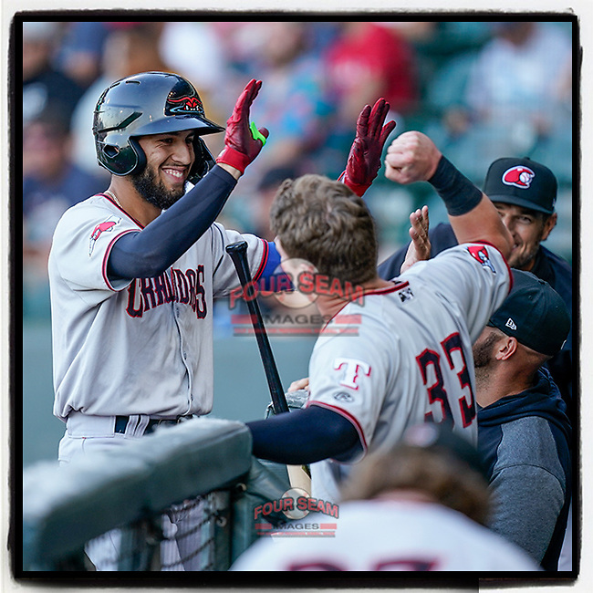 Jonathan Ornelas (3) of the Hickory Crawdads is greeted at the dugout steps by Kellen Strahm (33) after hitting a third-inning home run in a game against the Greenville Drive on Wednesday, June 16, 2021, at Fluor Field at the West End in Greenville, South Carolina. (Tom Priddy/Four Seam Images)