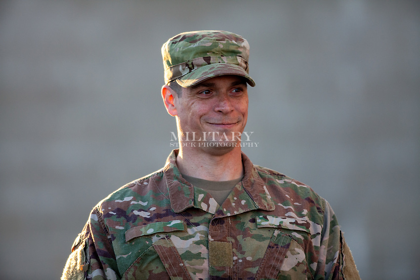 Portrait of a man in US Army uniform ready to give commands.