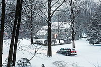 Car driving on an unpaved road during snow storm, Moorestown, New Jersey, USA