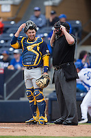 California Golden Bears catcher Brett Cumberland (28) and home plate umpire Reid Churchhill during the game against the Duke Blue Devils at Durham Bulls Athletic Park on February 20, 2016 in Durham, North Carolina.  The Blue Devils defeated the Golden Bears 6-5 in 10 innings.  (Brian Westerholt/Four Seam Images)