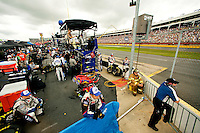 Members of Team Lowe's, the No. 48 Chevy Monte Carlo driven by Jimmie Johnson, wait out the rain along pit row at the Lowe's Motor Speedway, in Concord, NC, during the 2009 Coca-Cola Classic 600 NASCAR race. Driver David Reutimann won his first Cup race during the rain-shortened event, held May 25, 2009. NASCAR's longest scheduled race went only 227 laps, or 340.5 miles, before officials ended it because of rain. The 2009 race was the 50th running of the Coca-Cola 600. Ryan Newman and Robby Gordon finished second and third respectively.