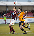 Stenny's Ross McMillan and Alloa's Martin Grehan challenge for the ball.