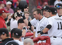 Infielder LB Dantzler (20) of the South Carolina Gamecocks is congratulated after hitting a solo home run in a game against the Clemson Tigers on March 3, 2012, at Carolina Stadium in Columbia, South Carolina. South Carolina won, 9-6. (Tom Priddy/Four Seam Images)