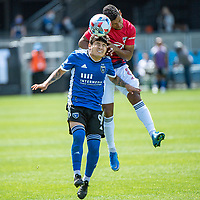 SAN JOSE, CA - APRIL 24: Eduardo Lopez #9 of the San Jose Earthquakes goes up for a header with Bryan Acosta #8 of FC Dallas during a game between FC Dallas and San Jose Earthquakes at PayPal Park on April 24, 2021 in San Jose, California.