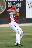 Matt Fairel #30 of the Carolina Mudcats throwing in the outfield before a game against the West Tenn Diamond Jaxx on May 30, 2010 in Zebulon, NC.