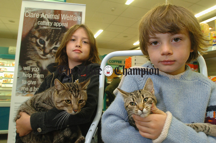 """At the launch of the Clare Animal Welfare  Cattery Appeal at Shaughnessy's Mace shop on Station road, Ennis were Isabel and Tull Spellissey with their cats """"Goose"""" and """"Express"""". Photograph by John Kelly."""