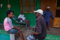 Haiti, Gros-Morne. Scholar girls through Mercy Beyond Borders doing community service at old people's home.