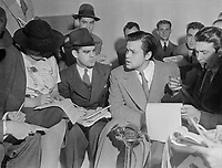 31 Oct 1938 --- Actor Orson Welles explains the radio broadcast of H.G. Wells' The War of the Worlds to reporters after it caused widespread panic.