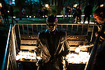 © Joel Goodman - 07973 332324 . 31/08/2015 . Manchester , UK . People leave lit candles beside a statue of Alan Turing at a candlelit vigil in memory of the victims of HIV and AIDS , in Sackville Gardens in Manchester's Gay Village , closes 2015 Manchester Pride . Photo credit : Joel Goodman