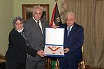 Palestinian president Mahmoud Abbas honors the late journalist Makram Mohamed Ahmed, in Cairo, Egypt, on September 2, 2021. Photo by Thaer Ganaim