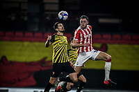 4th November 2020; Vicarage Road, Watford, Hertfordshire, England; English Football League Championship Football, Watford versus Stoke City; Harry Souttar (Stoke City) competes for the ball against Watford's Craig Cathcart.