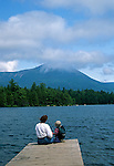 Mother and son enjoying a view of Mt. Katahdin at Daicey Pond, Baxter State Park, Maine, USA