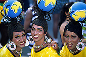Salvador, Bahia State, Brazil. Carnival; transvestites with 'Olodrag Timbaleira' earrings, bottle top necklaces and globes.