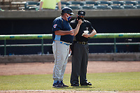 Myrtle Beach Pelicans manager Buddy Bailey (left) has a discussion with home plate umpire Ethan Gorsak during the game against the Lynchburg Hillcats at Bank of the James Stadium on May 23, 2021 in Lynchburg, Virginia. (Brian Westerholt/Four Seam Images)