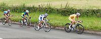 Shara Gillow (Australia, #21) leads Evelyn Yesenia Garcia Marroquin (El Salvador,#51).  Olympics 2012.  Women's cycle road race passes along the Shere bypass, the A25, on it's way to Box Hill and then back to the finish in London.