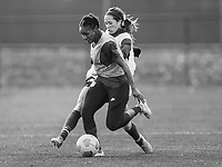 COMMERCE CITY, CO - OCTOBER 25: Crystal Dunn and Shea Groom of the USWNT fight for the ball at Dick's Sporting Goods training fields on October 25, 2020 in Commerce City, Colorado.
